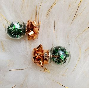 Vintage snowglobe stud earrings with green stars